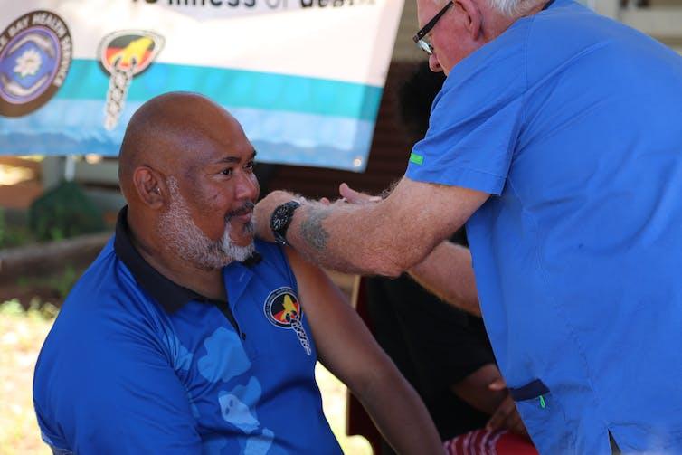Aboriginal elder receives a coronavirus vaccine.