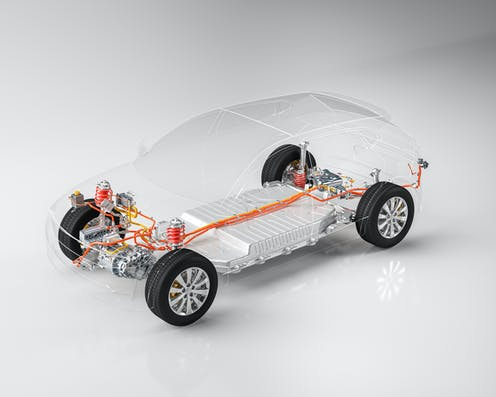 A see-through electric car with battery and cables highlighted.