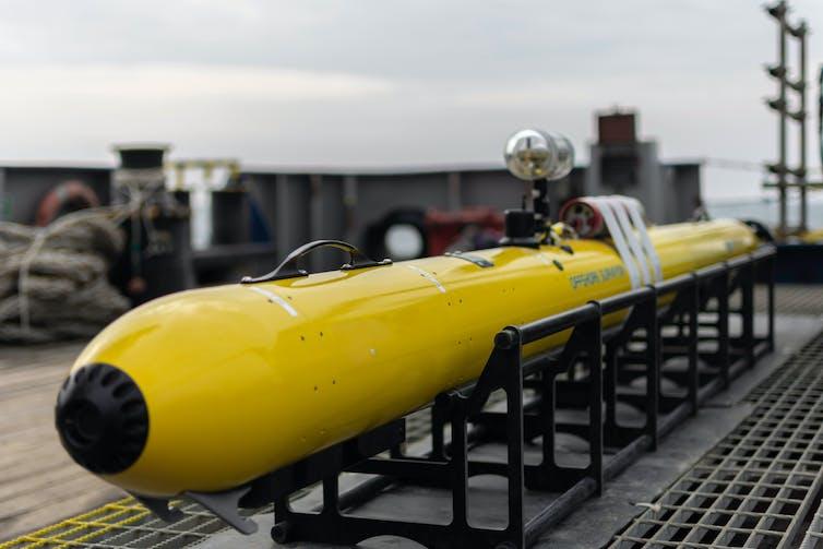 An Autonomous Underwater Vehicle (AUV) on deck.