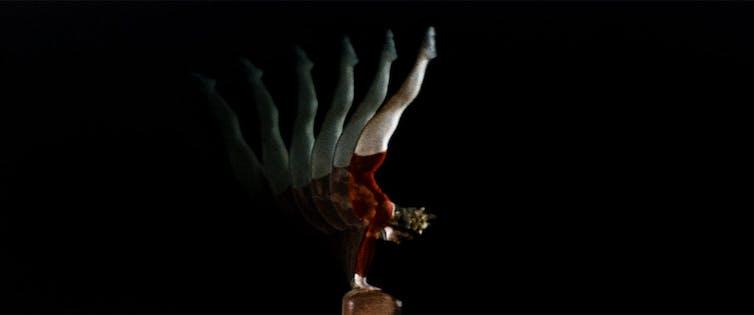 A gymnast mid-flip.