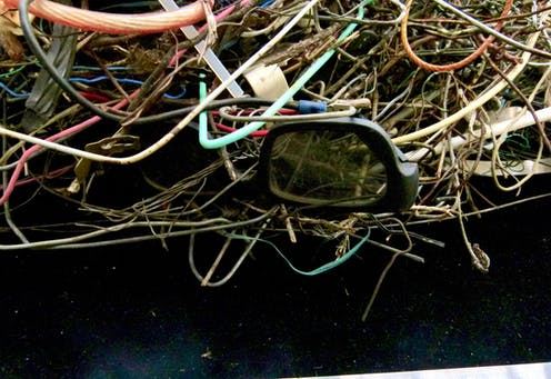 A tangle of 3D glasses, wires and cables