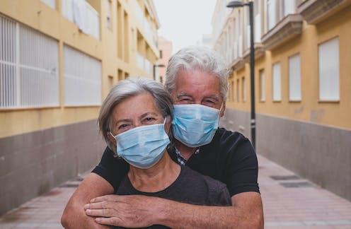 Elderly couple wearing face masks