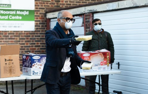 Members of Wapping Mosque distributing food during the pandemic