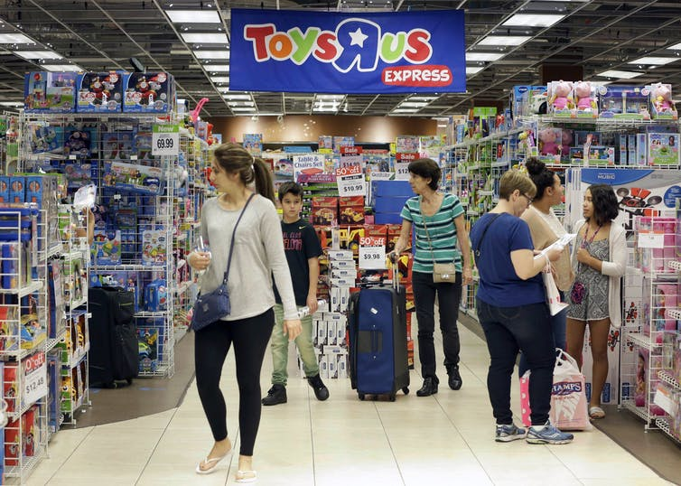 Shoppers in a Toys 'R' Us.