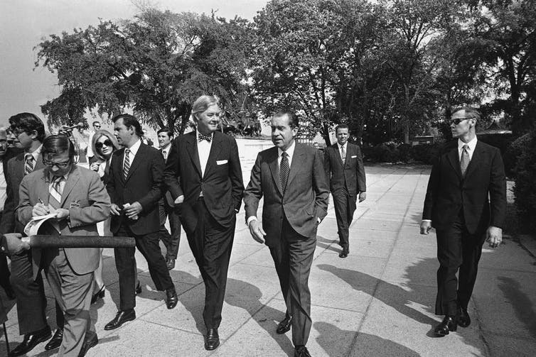 President Richard Nixon, center, accompanied by Daniel Patrick Moynihan