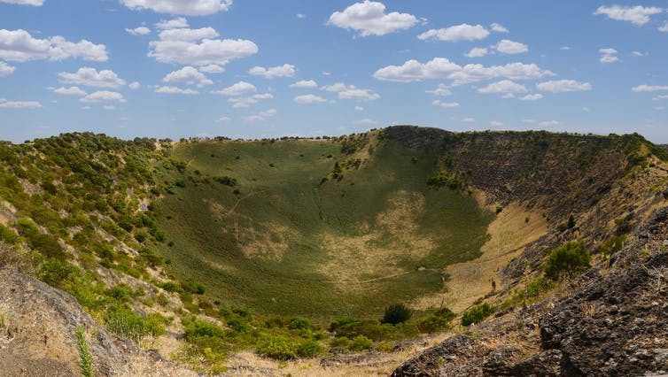 Green, volcanic crater