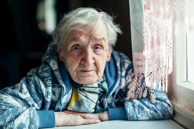 An elderly woman at home.