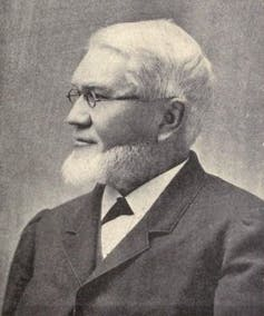 Profile photo of Bishop with a beard and glasses and wearing a suit