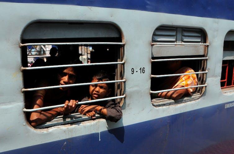 people look out train window