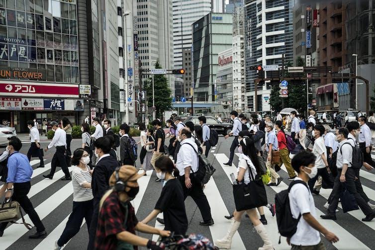 Morning pedestrian traffic in Tokyo on July 13 2021.