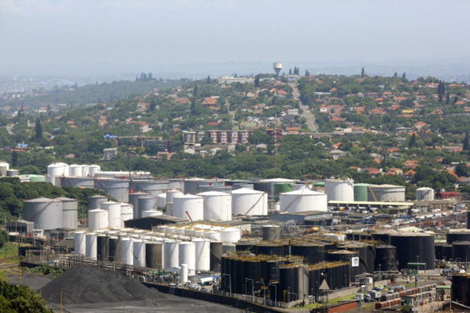 View of city with large storage tanks in the foreground