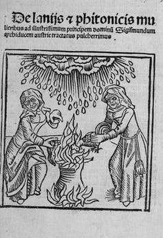 Illustration of witches with a cauldron and rain.