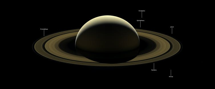 Saturn and several of its moons, backlit, as seen from the Cassini spacecraft in September 2017.