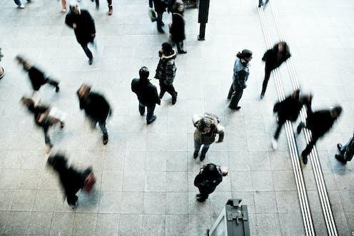 People walking around at an airport