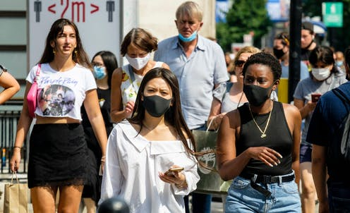 People in masks shopping on Oxford Street