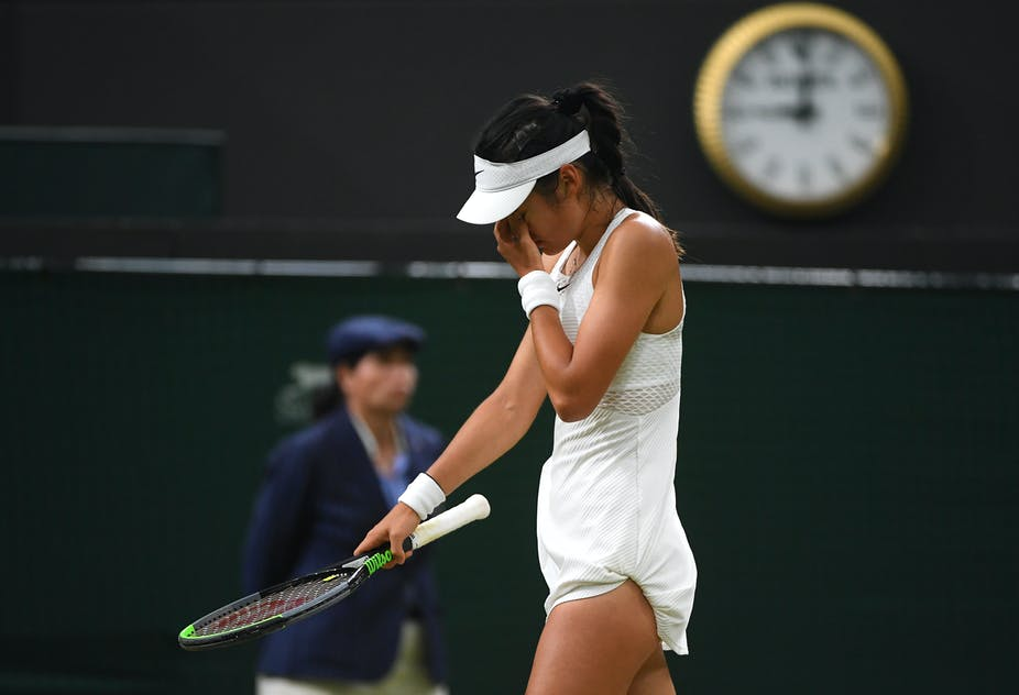 Tennis player Emma Raducanu hold her face during her fourth-round match at Wimbledon, where she was forced to retire due to medical reasons.