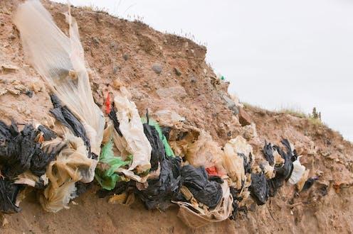 Eroding cliff reveals rubbish