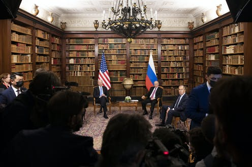 An image of Biden and Putin sitting beneath their respective flags in the library of the Villa La Grange, Geneva on June 16 2021.