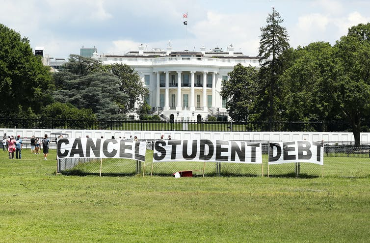 sign reading 'cancel student debt' outside white house