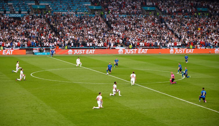 England and Italy football teams take a knee on the Wembley Stadium pitch before Euro 2020 final