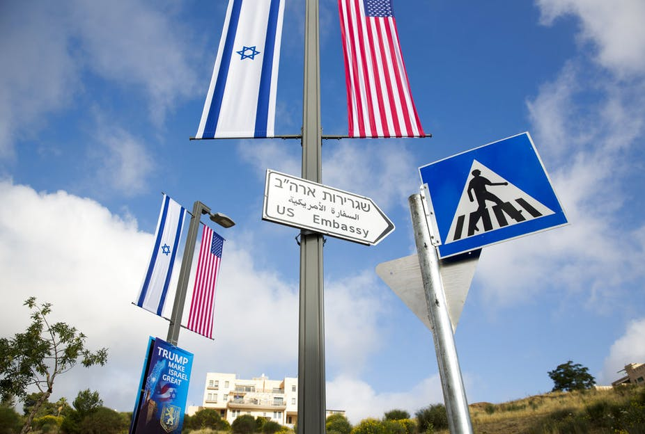 A road sign leading to the U.S. Embassy is seen ahead the official opening in Jerusalem, Sunday, May 13, 2018.