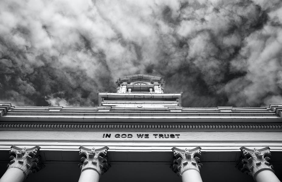 Black and white image of government building/courthouse in small town America.