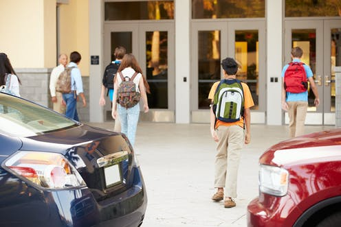 Students walking into school.