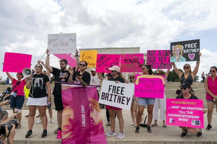 Fans of Britney Spears hold up signs with such messages as 'Free Britney' at the steps of the Lincoln Memorial in Washington