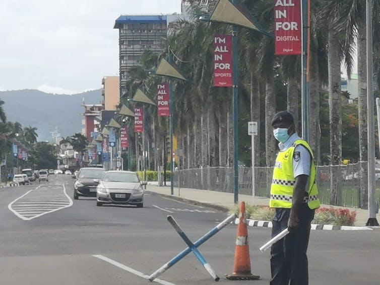 Fijian police officer at roadblock in Suva