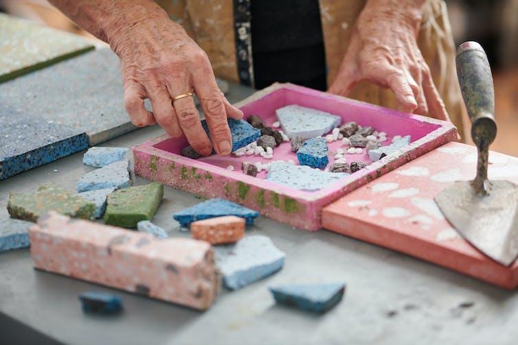 woman making terrazzo tile