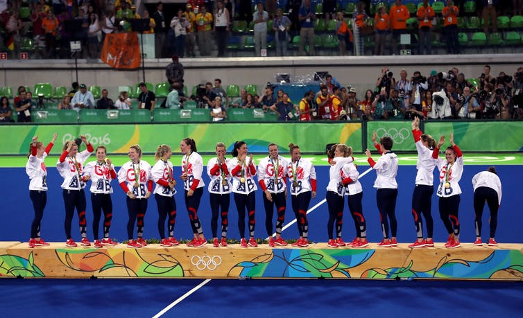 The Team GB women's hockey players celebrate their win on the podium at the Rio 2016 Games
