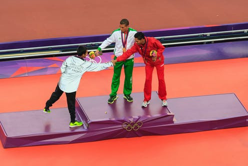 Athletes congratulate each other on the podium during the London 2012 Olympic Games