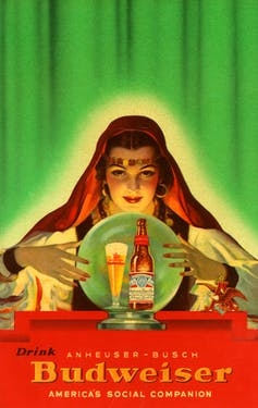 An ad for Budweiser depicts a psychic over a crystal ball with a Budweiser bottle in it.