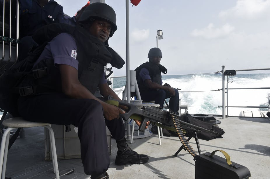 Nigerian naval members sit in a vessel during Obangame Express, a multinational maritime exercise involving 33 countries off the coast of Lagos on March 20, 2019.
