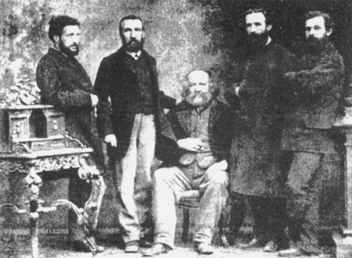 Mikhail Bakunin surrounded by fellow members of the International Workingmen's Association in a 1869 photo.
