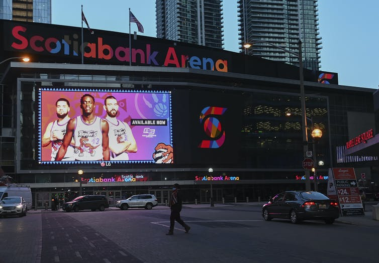 Scotiabank Arena with a billboard-sized image of the Toronto Raptors in front