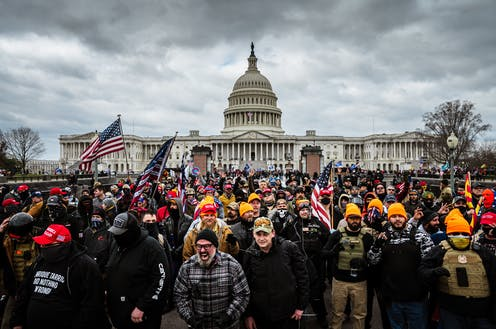 A group of angry people rallying in front of the US Capitol on January 6, 2021.