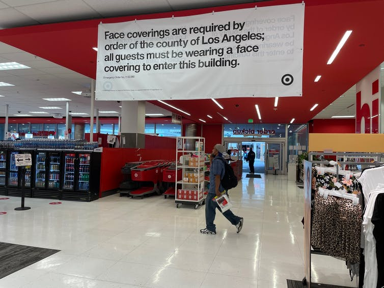 Sign inside the target indicating that masks must be worn