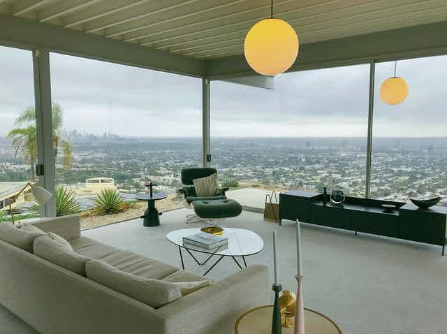 An elevated lounge room looks over a far away city
