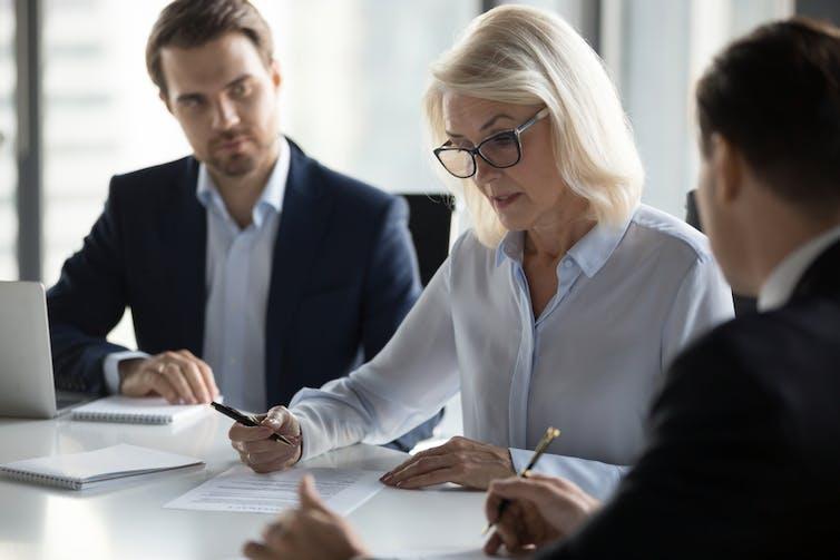 Three auditors at a desk