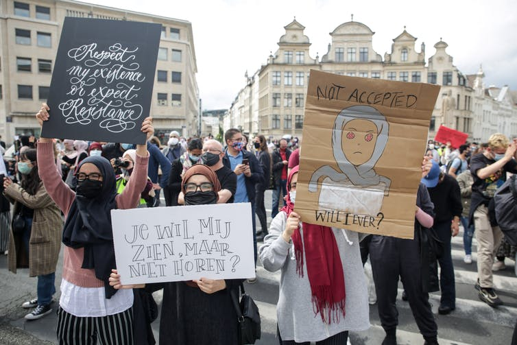 Participants at a rally for the right to wear a hijab in Brussels universities