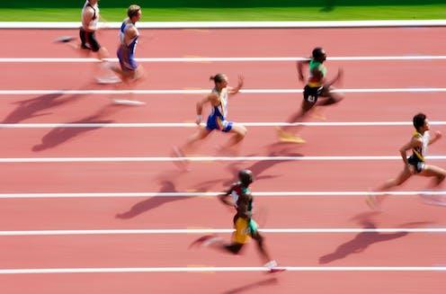 Sprinters on a race track.