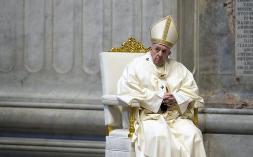 Pope Francis seated during a celebration of Holy Mass.