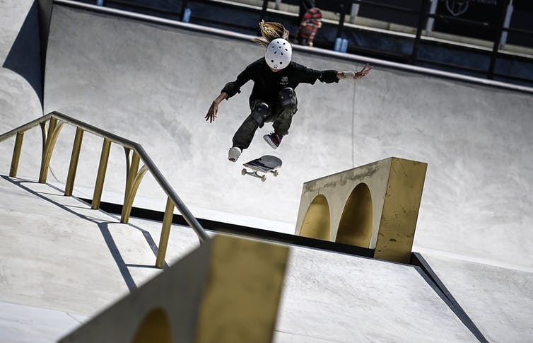 A woman competes in a pre-Olympic skateboarding competition.