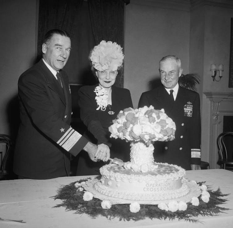 Mushroom cloud cake is cut.