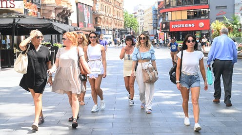 People walking through Leicester Square in London