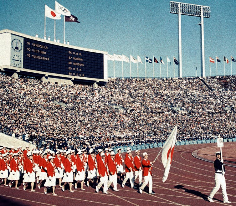 Japanese athletes march at National Stadium during the Tokyo Olympics opening ceremony