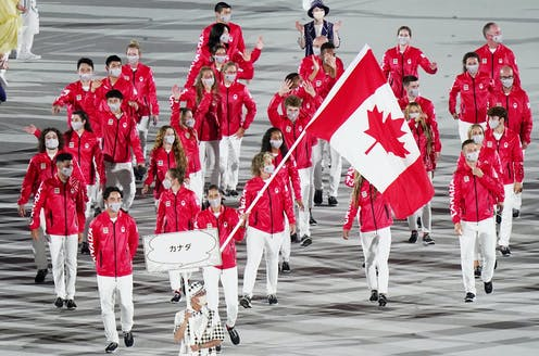 A small group of Canadian athletes march in the opening ceremonies.