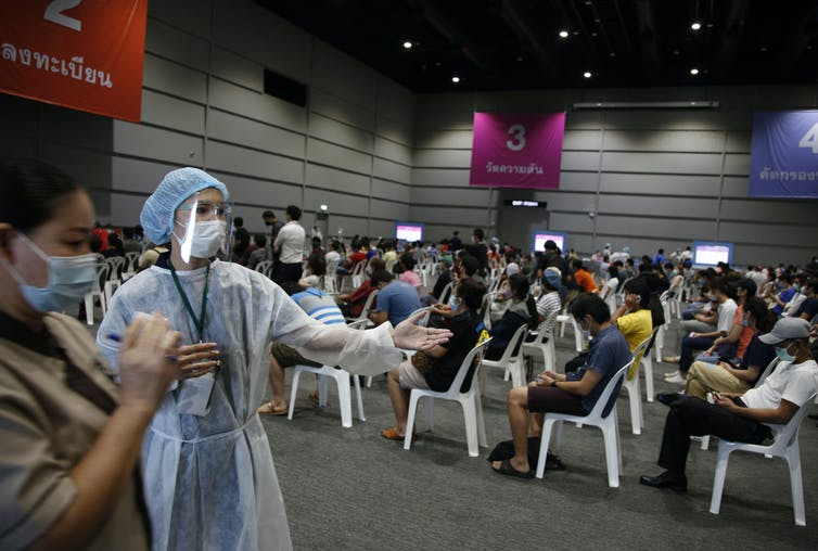 People waiting to be vaccinated at a vaccine centre in Bangkok, Thailand