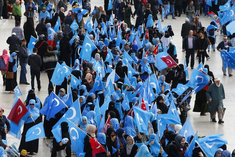 Members of the Uighur community living in Turkey carry flags of what ethnic Uighurs call 'East Turkestan', during a protest in Istanbul, against oppression by the Chinese government to Muslim Uighurs in China.